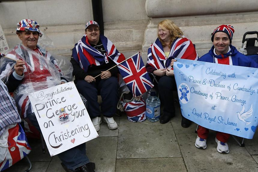 British Royal Family fans from left, Terry Hutt, Julie Cain, Marie Scott and John Loughrey camp up outside the Chapel Royal, St James's Palace in London ahead of the christening of Prince George, Tuesday, Oct. 22, 2013. -- PHOTO: AFP