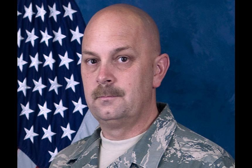 Master Sgt. Michael Landsberry, a former Marine who also served in the Nevada Air National Guard and taught math at Sparks Middle School, is shown in this Nevada National Guard photo released to Reuters on October 22, 2013. A US teacher killed