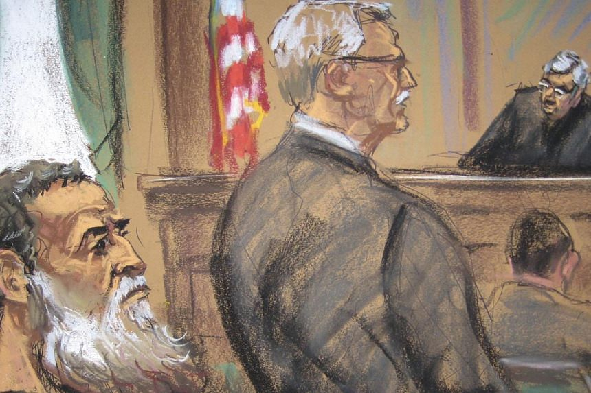A courtroom sketch shows Nazih al-Ragye known by the alias Abu Anas al-Liby as he appears with his attorney Bernard Kleinman (centre) before Judge Lewis A Kaplan in Manhattan Federal Court in New York on Oct 22, 2013. Libi, 49, has pleaded not guilty