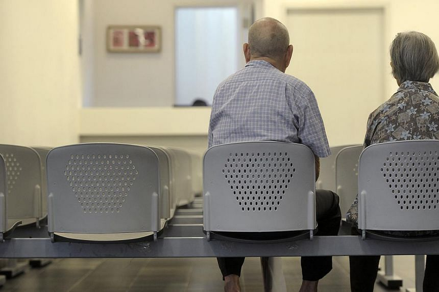 An elderly couple at the Choa Chu Kang Polyclinic. The No. 1 worry of Singaporeans is the cost linked to the growing pool of old folk, according to a global survey. -- ST FILE PHOTO: JOSEPH NAIR