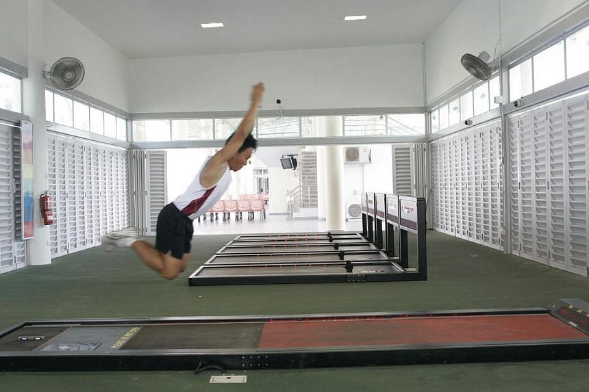 Servicemen would likely welcome the scrapping of the standing broad jump (above). A good number of them fail the station and have to undergo remedial training. -- ST FILE PHOTO