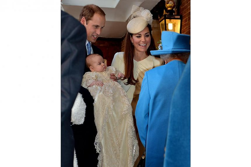 Britain's Queen Elizabeth II (right) speaks with Prince William and Kate Duchess of Cambridge as they arrive with their son Prince George at the Chapel Royal in St James's Palace on Wednesday, Oct 23, 2013. -- PHOTO: AP