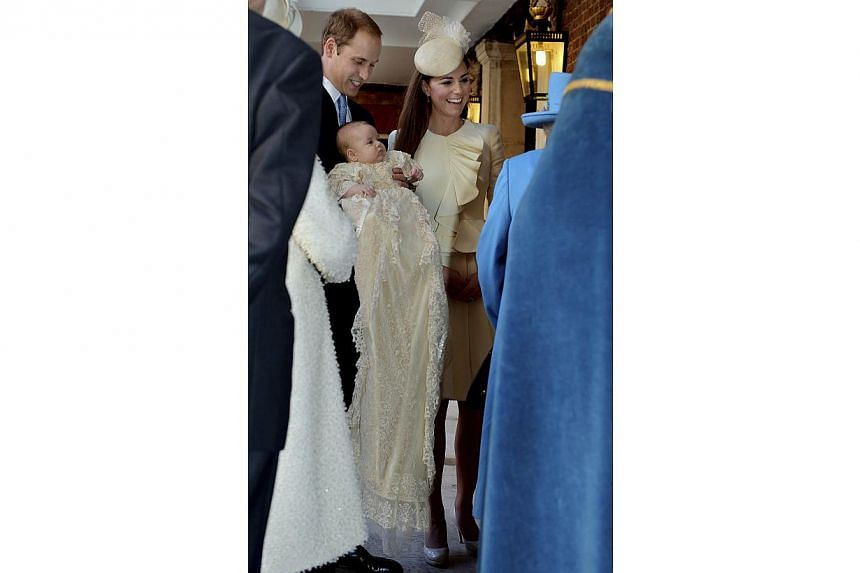 Britain's Prince William carries his son Prince George, as he arrives with his wife Catherine, Duchess of Cambridge for their son's christening at St James's Palace in London on Wednesday, Oct 23, 2013. -- PHOTO: REUTERS