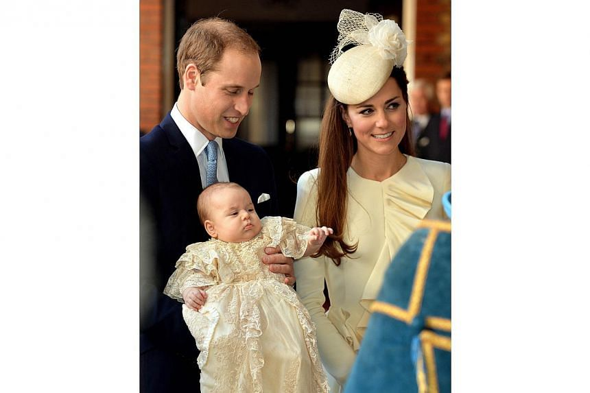 Britain's Prince William, Duke of Cambridge and his wife Catherine, Duchess of Cambridge, arrive with their son Prince George of Cambridge at Chapel Royal in St James's Palace in central London on Wednesday, Oct 23, 2013, ahead of the christening of