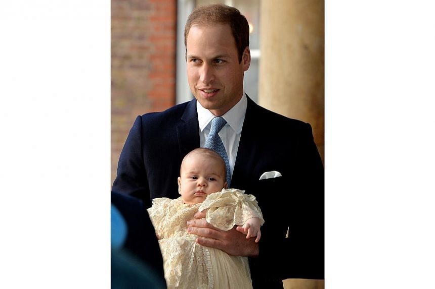 Britain's Prince William holds his son Prince George as they arrive at Chapel Royal in St James's Palace in London, for the christening of the three-month-old George on Wednesday, Oct 23, 2013. -- PHOTO: AP