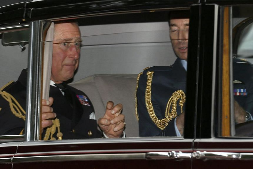 Britain's Prince Charles (left) arrives for the christening of Prince George at St James's Palace in London on Wednesday, Oct 23, 2013. -- PHOTO: REUTERS