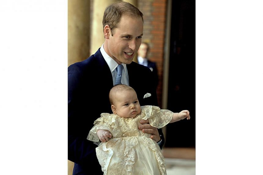 Britain's Prince William holds his son Prince George as they arrive at Chapel Royal in St James's Palace in London, for the christening of the three-month-old George on Wednesday, Oct 23, 2013. -- PHOTO: REUTERS