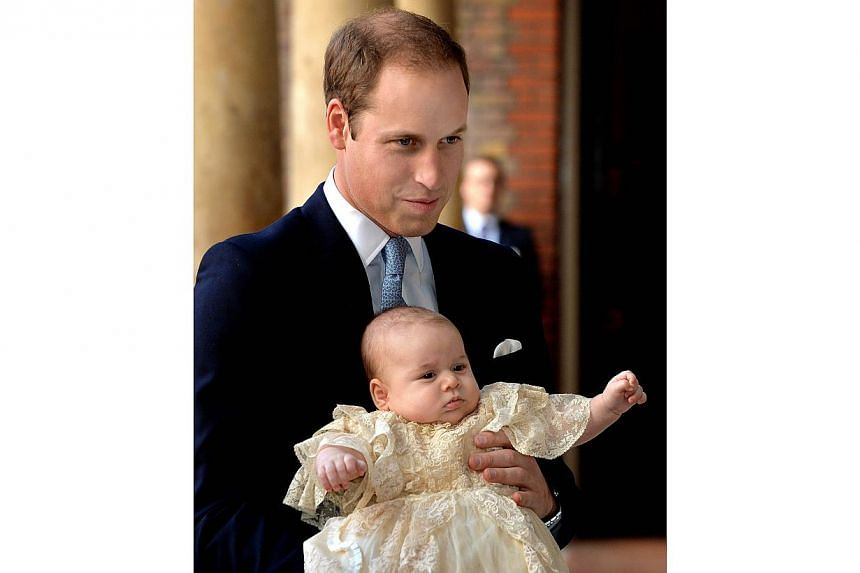 Britain's Prince William holds his son Prince George as they arrive at Chapel Royal in St James's Palace in London, for the christening of the three-month-old George on Wednesday, Oct 23, 2013. -- PHOTO: AFP
