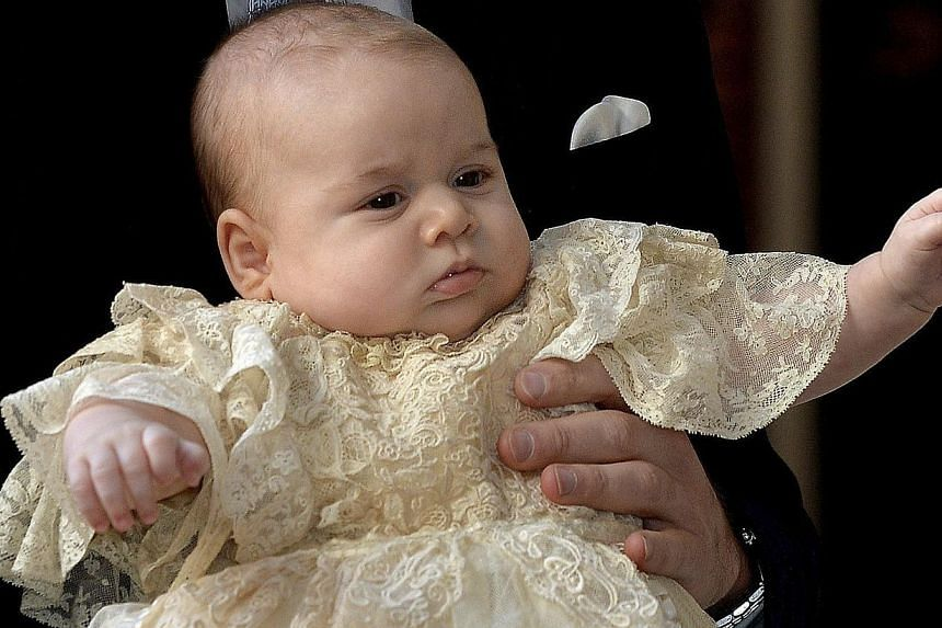 Britain's Prince George is held by his father Prince William as they arrive at Chapel Royal in St James's Palace in London, for the christening of the three-month-old George on Wednesday, Oct 23, 2013. -- PHOTO: AP
