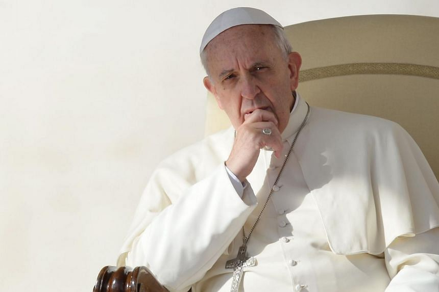 """Pope Francis (above) on Wednesday, Oct 23, 2013, called for a more humane justice system, saying God too was """"a prisoner"""" of the world's injustices and was in every cell. -- PHOTO: AFP"""