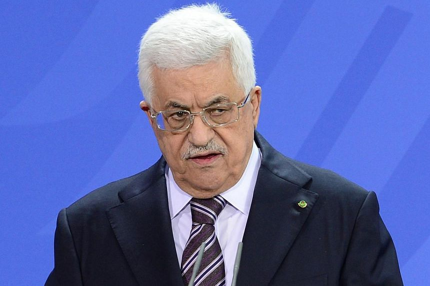 Palestinian president Mahmud Abbas gestures as he gives a press conference with the German Chancellor (not in picture) on Oct 18, 2013 at the Chancellery in Berlin. Palestinian president Mahmud Abbas warned on Tuesday Israel would be to blame if