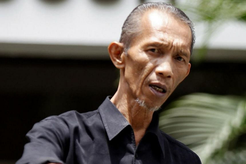Mohd Yusof Mohd Ali was sentenced to nine weeks' jail on Oct 23, 2013, for offering his nephew money and a job for taking the rap on his behalf for a driving offence. -- ST PHOTO: WONG KWAI CHOW