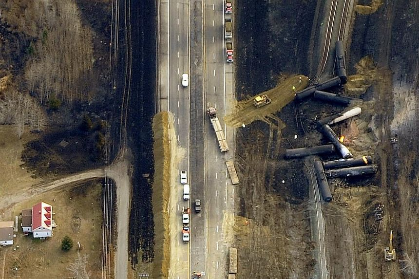 The site of a train derailment near the hamlet of Gainford, west of Edmonton, is seen in an aerial photo on Oct 20, 2013. Emergency braking was behind the derailment of a train hauling propane and crude oil early on Saturday, the Transport