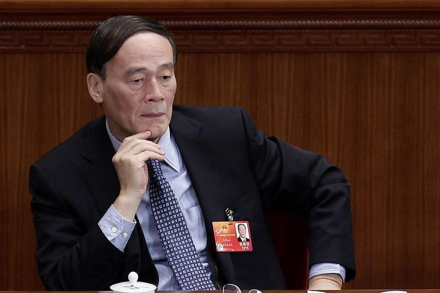 China's then vice-premier Wang Qishan attends a plenary meeting of the National People's Congress at the Great Hall of the People in Beijing on March 8, 2012. Mr Wang, now the head of the Central Commission for Discipline Inspection,warned staf