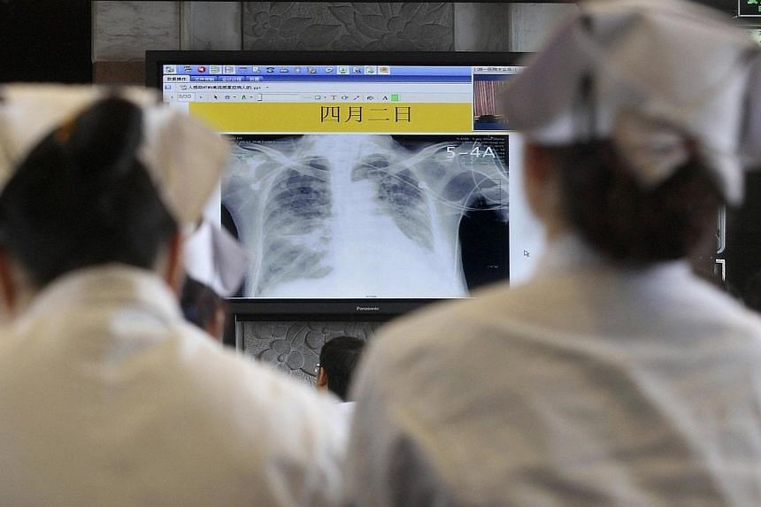 Doctors and nurses attend a training course for the treatment of the H7N9 virus at a hospital in Hangzhou, Zhejiang province, on April 5, 2013. China confirmed a new human case of the deadly H7N9 strain of bird flu on Wednesday, Oct 23, 2013, the sec