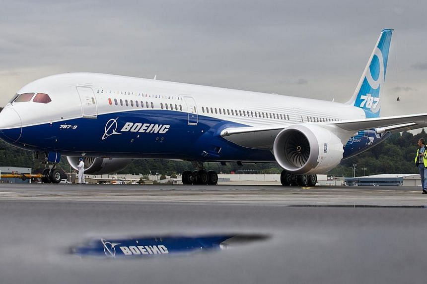 A Boeing 787-9 Dreamliner taxis after concluding its first flight September 17, 2013 at Boeing Field in Seattle, Washington. The 787-9 is twenty feet longer than the original 787-8, can carry more passengers and more fuel.  Boeing rai