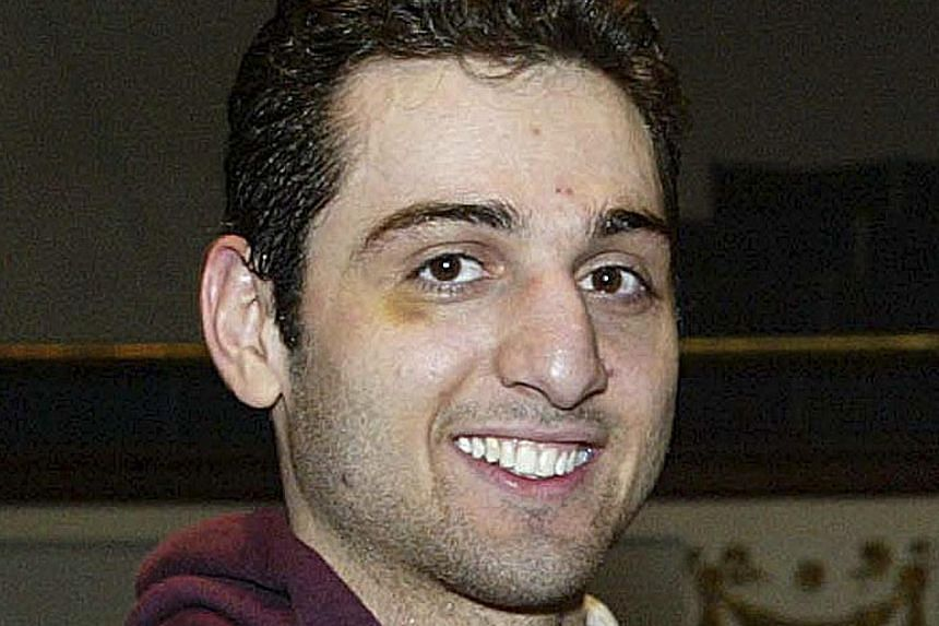 In this Feb. 17, 2010, file photo, Tamerlan Tsarnaev smiles after accepting the trophy for winning the 2010 New England Golden Gloves Championship in Lowell, Mass. Tamerlan Tsarnaev, the older brother in the suspected Boston bombings duo, has be