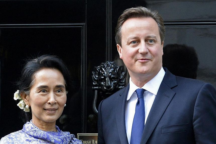 Britain's Prime minister David Cameron greets Myanmar pro-democracy leader Aung San Suu Kyi as she arrives for their meeting at Number 10 Downing Street in London on Oct 23, 2013. Mr Cameron said on Wednesday he would help build international pressur