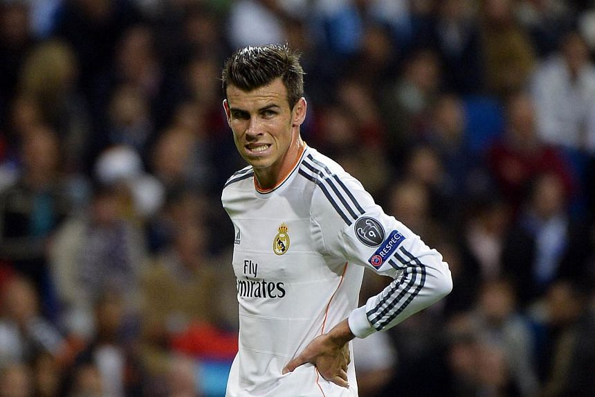 Real Madrid's Welsh striker Gareth Bale looks on during the UEFA Champions League Group B football match Real Madrid CF vs Juventus at the Santiago Bernabeu stadium in Madrid on October 23, 2013.The Real fans showed they are impatient to see Ba
