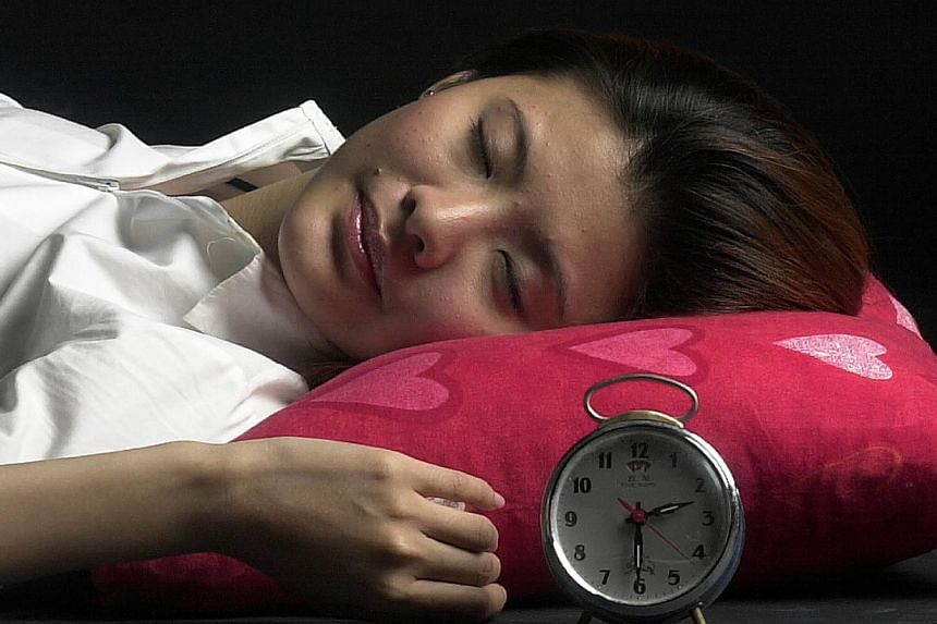 Most Singaporeans are sleep-deprived, do not exercise enough, and do not go for health screenings, according to a regional survey commissioned by AIA Singapore. -- ST FILE PHOTO:WANG HUI FEN