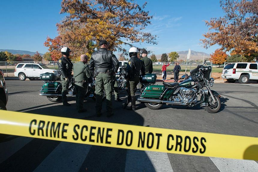 Police secure the scene near Sparks Middle School after a shooting in Sparks, Nevada, on Oct 21, 2013. A 13-year-old California boy carrying a replica of an assault rifle was shot and killed by sheriff's deputies who apparently believed the gun was r