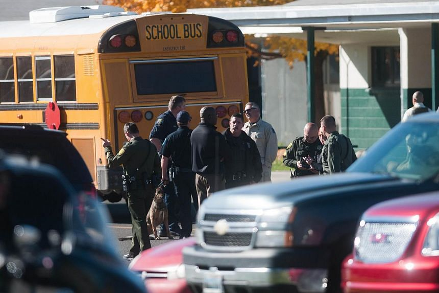 Law enforcement gather in the parking lot after a shooting at Sparks Middle School on Oct 21, 2013 in Sparks, Nevada. A 13-year-old California boy carrying a replica of an assault rifle was shot and killed by sheriff's deputies who apparently believe