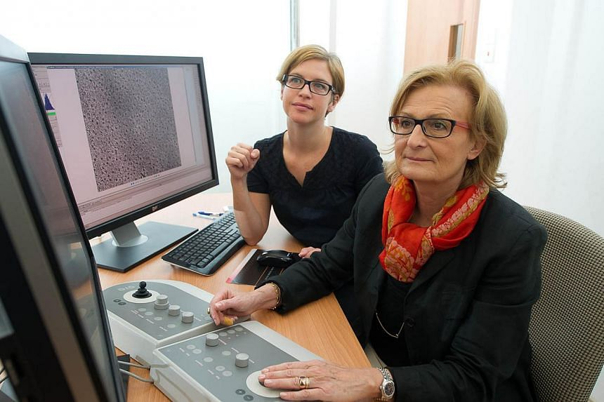 (Left) Asst Prof Sara Sandin and Prof Daniela Rhodes working with the new Tecnai Artica CryoEM microscope at the new Nanyang Technological University CryoEM Lab. -- PHOTO: NTU