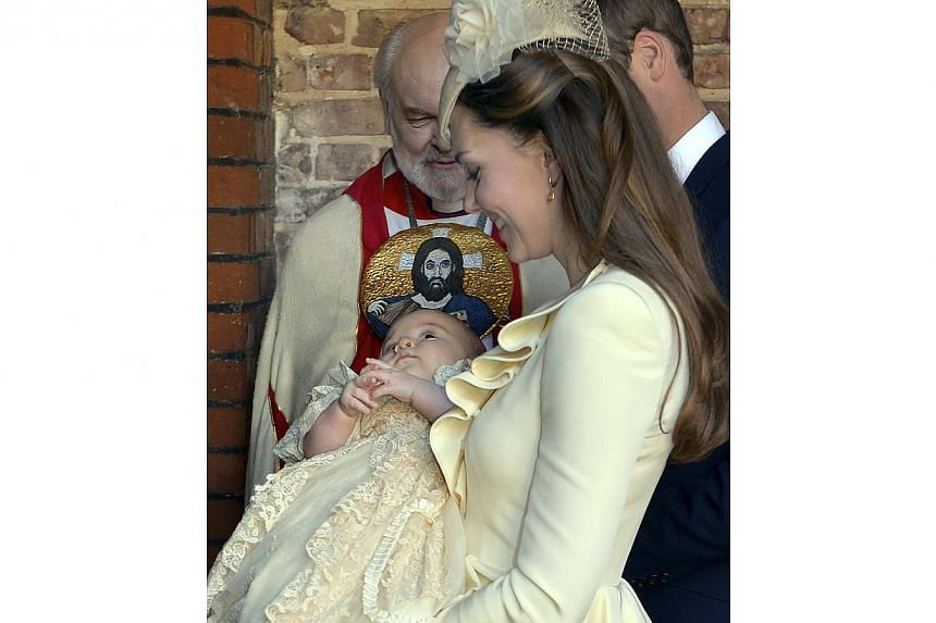 Britain's Catherine, Duchess of Cambridge walks with her husband Prince William as she carries her son Prince George after his christening at St James's Palace in London on Oct 23, 2013. -- PHOTO: REUTERS