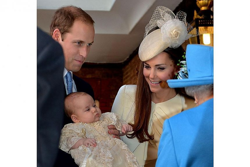 Queen Elizabeth II speaks with Britain's Prince William, Duke of Cambridge and his wife Catherine, Duchess of Cambridge, as they arrive with their son Prince George of Cambridge for his Christening at Chapel Royal in St James's Palace in central Lond