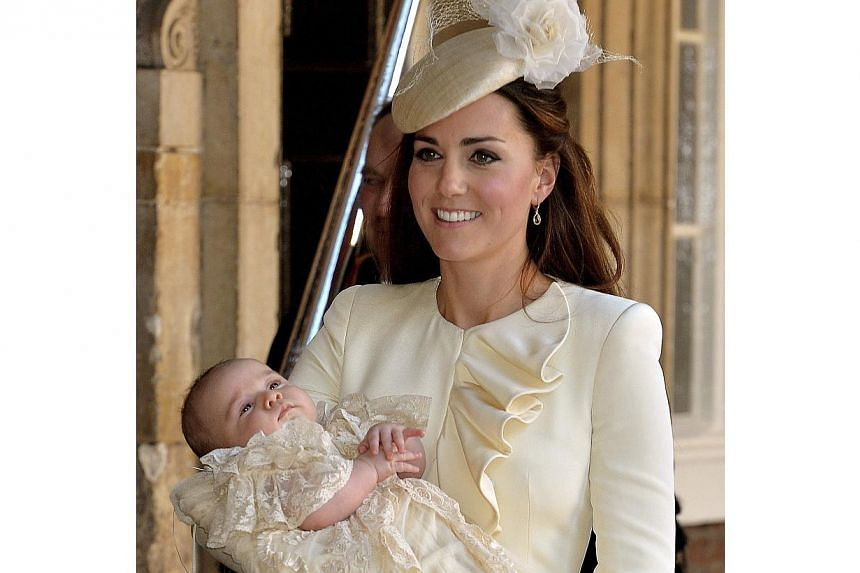 Kate Duchess of Cambridge carries her son Prince George after his christening at the Chapel Royal in St James's Palace in London, on Wednesday, Oct 23, 2013. -- PHOTO: AP
