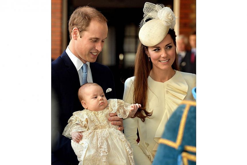 Britain's Prince William, Duke of Cambridge and his wife Catherine, Duchess of Cambridge, arrive with their son Prince George of Cambridge at Chapel Royal in St James's Palace in central London on Oct 23, 2013, ahead of the christening of the three m