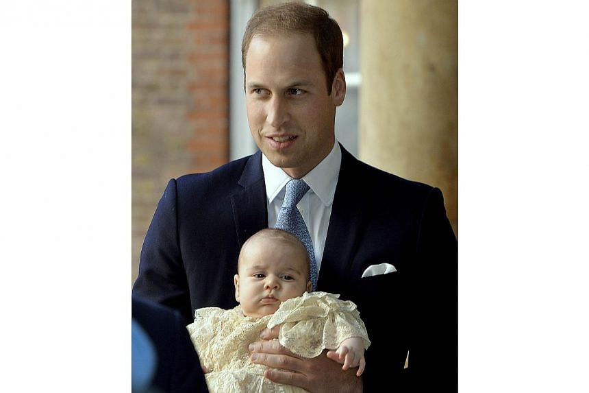 Britain's Prince William carries his son Prince George as they arrive for his son's christening at St James's Palace in London on Oct 23, 2013. -- PHOTO: REUTERS