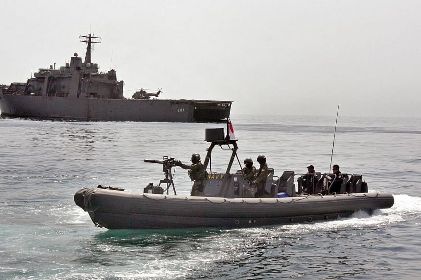 The Republic of Singapore Navy's (RSN) RSS Endurance is pictured with one of its fast craft in the Gulf of Aden on 2010.Singapore will answer the call of duty - for the ninth time since 2009 - to support international counter-piracy efforts in