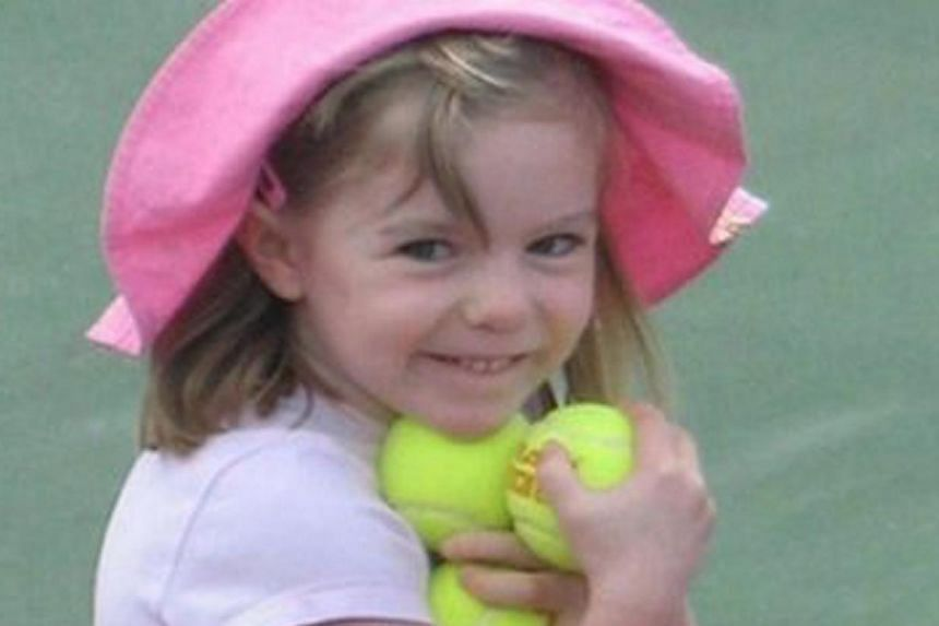 This undated image released on Sunday, Oct 13, 2013, by the London Metropolitan Police, shows missing British girl Madeleine McCann before she went missing from a Portuguese holiday complex on Thursday, May 3, 2007. The Portuguese police are reo