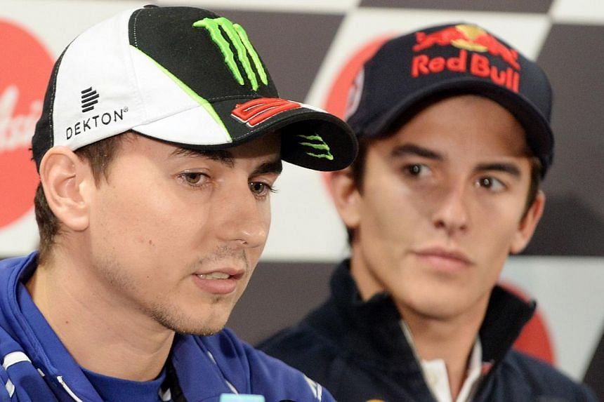 Jorge Lorenzo (left) has insisted he still has a fighting chance of retaining his motorcycling world title, as pressure builds on gaffe-hit championship leader Marc Marquez (right) ahead of the Japanese MotoGP. -- PHOTO: AFP