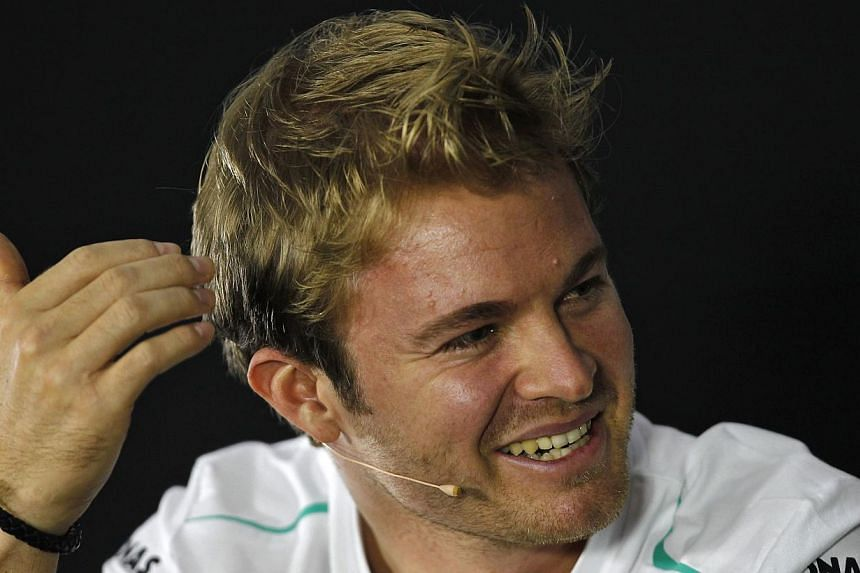 Germany's Nico Rosberg (above) on Thursday, Oct 24, 2013, insisted that Formula One was still interesting for the fans despite Sebastian Vettel's march towards a fourth straight title. -- PHOTO: REUTERS