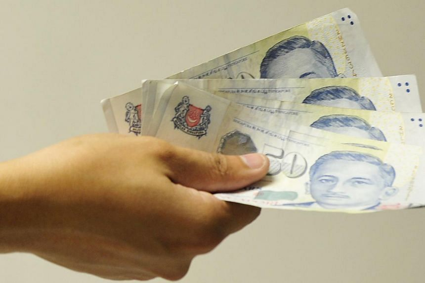 Higher interest rates may not hurt Singapore borrowers as deeply as some have feared, according to a new survey by Credit Suisse. -- ST FILE PHOTO:MUGILAN RAJASEGERAN