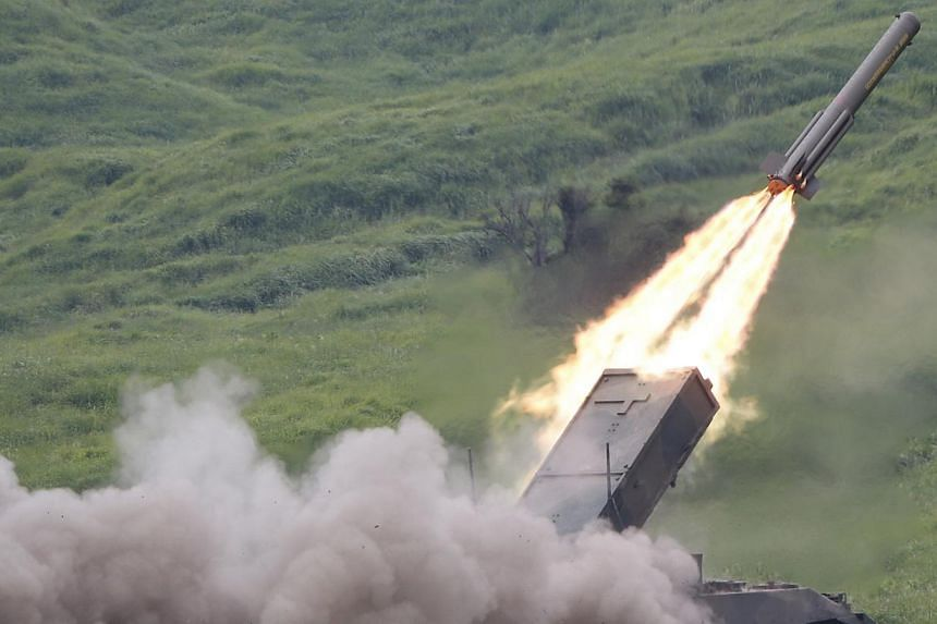 In this Tuesday, Aug. 20, 2013 file photo, a Japan Ground Self-Defense Force anti-land mine missile is launched during an annual live firing exercise at Higashi Fuji range in Gotemba, south-west of Tokyo. -- FILE PHOTO: AP