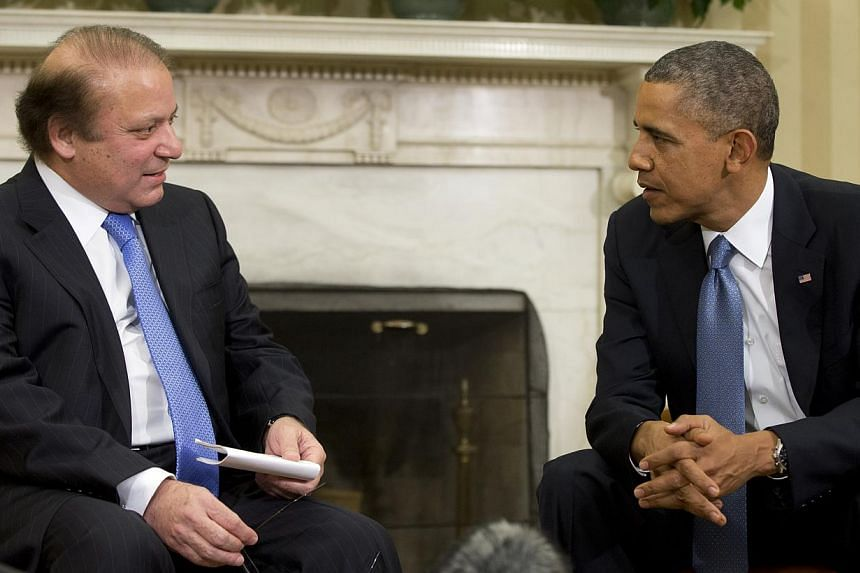 President Barack Obama (right) meets with Pakistan Prime Minister Nawaz Sharif in the Oval Office of the White House in Washington, on Wednesday, Oct 23, 2013. Pakistan for years secretly approved of US drone attacks on its territory despite public d