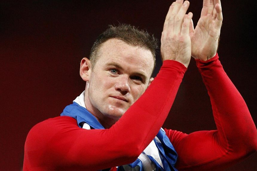 Manchester United's Wayne Rooney applauds supporters after his team's Champions League group A soccer match between Manchester United and Real Sociedad in Manchester, England, on Wednesday, Oct 23, 2013. Rooney was glad former manager Alex Ferguson h