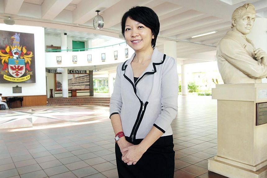 Raffles Institution's first woman principal, Mrs Lim Lai Cheng, will be joining the Singapore Management University as a faculty member in January next year.-- BT FILE PHOTO:YEN MENG JIIN