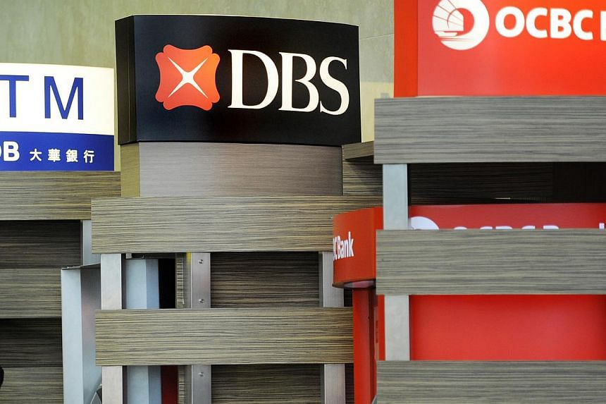 Singapore's lenders look to be on the hunt for acquisitions to accelerate their regional expansions, with all three said to be eyeing stakes in other banks. -- FILE PHOTO: BLOOMBERG