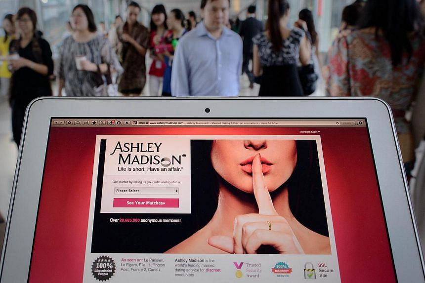 This photo illustration taken on Aug 20, 2013 shows the homepage of the Ashley Madison dating website displayed on a laptop in Hong Kong. Ashley Madison, a dating website targeting married spouses, is not welcome in Singapore, said Minister for Socia