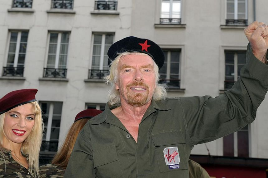 Mr Richard Branson arrives aboard a jeep to attend a press conference by French telecom company Virgin Mobile for the presentation of Virgin Mobile's new offer Telib in Paris on Sept 18, 2013. -- FILE PHOTO : AFP
