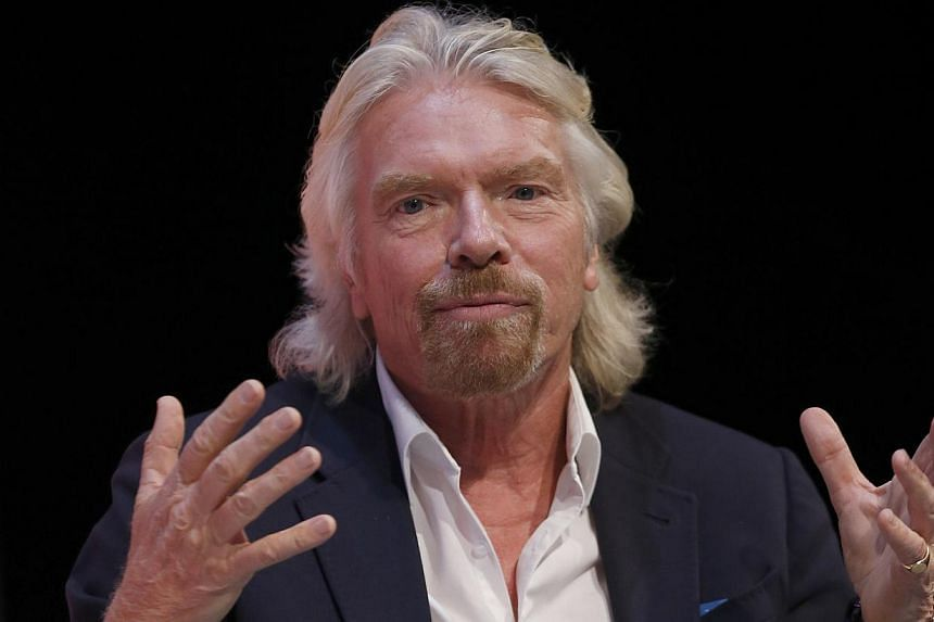 Mr Richard Branson speaks at the Institute of Directors annual convention in London on Sept 18, 2013. Mr Branson said on Thursday his decision to quit Britain to live on his private Caribbean island was not to dodge paying United Kingdom (UK) tax but