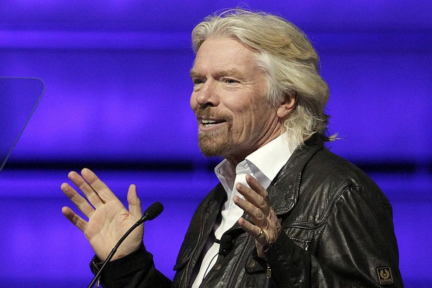 Mr Richard Branson speaks to some 300 potential space flight customers at a Virgin Galactic hangar at Mojave Air and Space Port in Mojave, California, Wednesday, Sept 25, 2013.  - FILE PHOTO: AP