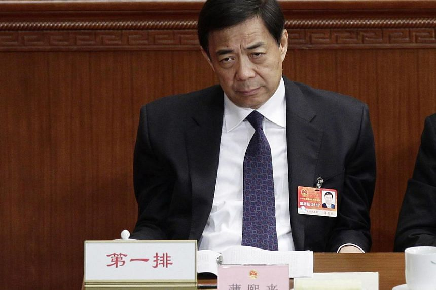 Then politician Bo Xilai pauses as he attends a plenary meeting of China's parliament, the National People's Congress, at the Great Hall of the People in Beijing on March 10, 2011. Bo saw his appeal against a life sentence rejected on Friday morning