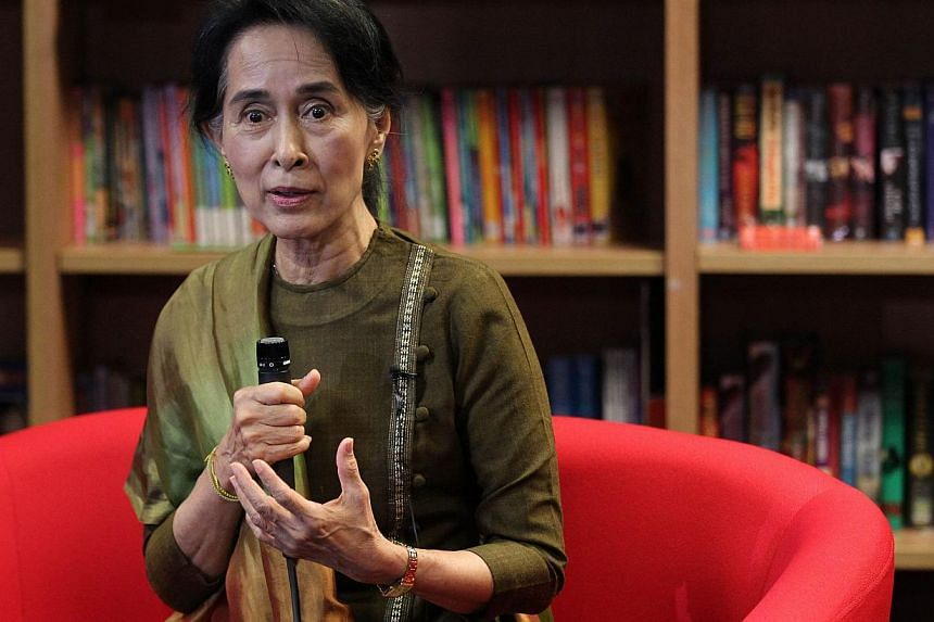Myanmar opposition leader Aung San Suu Kyi speaks to pupils at Wellington College in Belfast, Northern Ireland, on Oct 24, 2013.Ms Suu Kyi said Northern Ireland's peace process could help reconciliation in Myanmar, as the Nobel peace laureate v