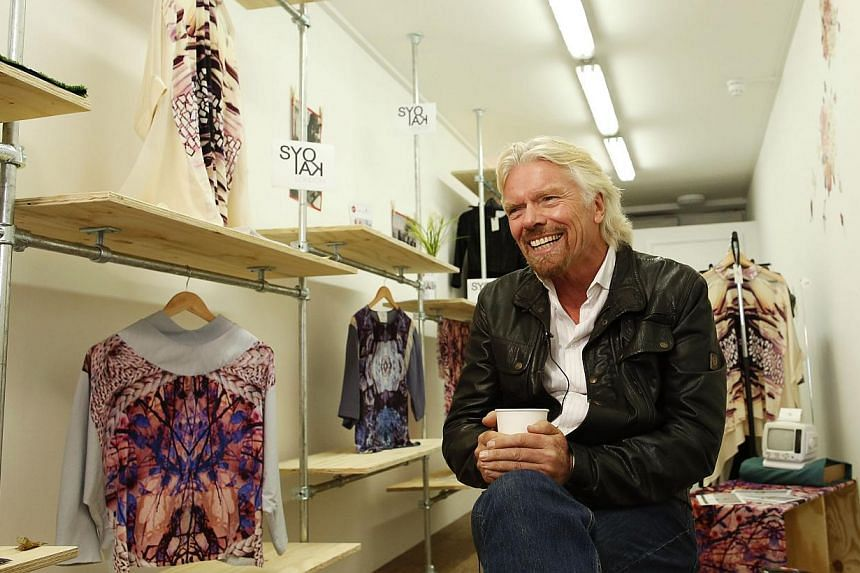 Mr Richard Branson, Founder of Virgin Group, is interviewed by Reuters about the Virgin StartUp scheme for young entrepreneurs, at Box Park in east London, on Oct 24, 2013. -- PHOTO: REUTERS