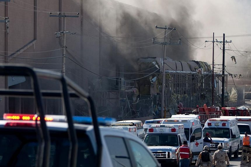 Smoke billows from a United States-owned candy factory in Ciudad Juarez, northern Mexico, after a boiler exploded on Oct 24, 2013. The blast caused the ceiling to collapse, injuring more than 40 people and leaving 20 more missing, officials sai